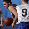 Ricky Reynolds, left, drives to the lane during a PBA basketball game on Saturday. David Le/Salem News