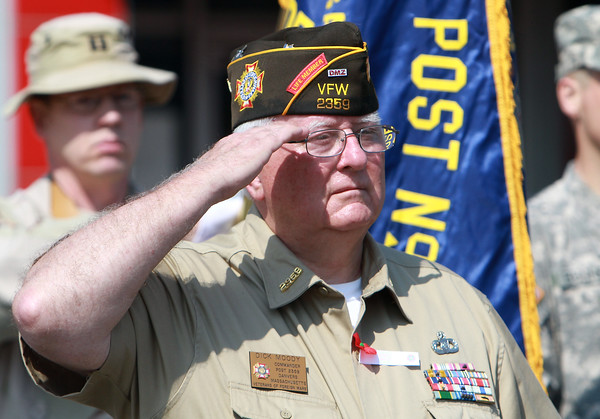 Commander Dick Moody of Color Guard stands at attention while Taps are played in Danvers Square during the Memorial Day Parade on Monday. David Le/Staff Photo