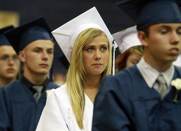 North Shore Tech graduate Lindsey Rigol listens intently to a speech by Salutatorian Chris Tufts on Friday evening. David Le/Staff Photo