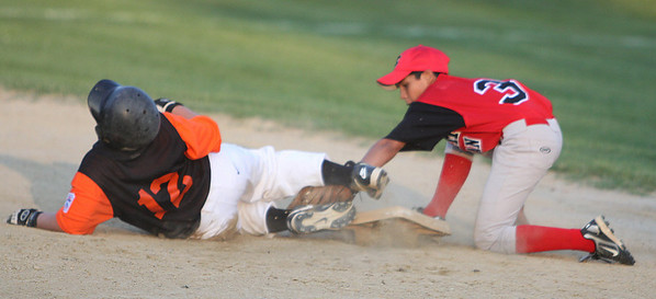 Gloucester: Beverly East's catcher Shawn Perry slides safely into secondbase as Salem American shortstop Paul Gauthier is just a second too late applying the tag. Beverly and Salem kicked off the all-star tournament games on Friday evening in Gloucester. Photo by David Le/Salem News