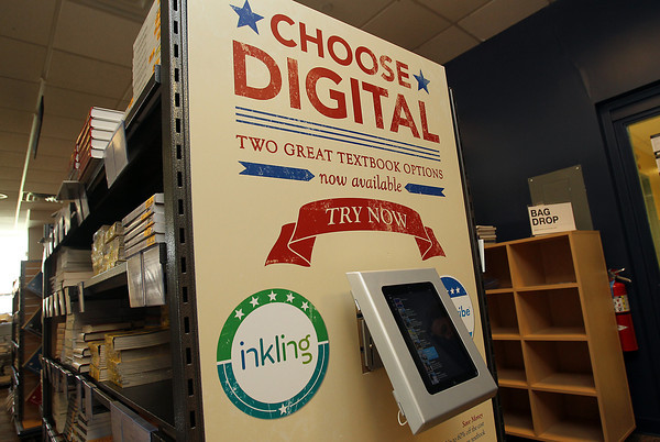 In between shelves of books in the Salem State University Bookstore, a new electronic, interactive textbook is on display for students to try. David Le/Staff Photo