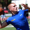Peabody quarterback Cody Wlasuk drops back to pass during a 7 on 7 Tournament at Bishop Fenwick High School on Saturday. David Le/Staff Photo