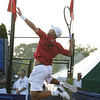Danvers: Tennis star James Blake of the Boston Lobsters soars in the air as he prepares to smash a volley back at his opponents in mixed doubles play  at the Ferncroft Country Club in Danvers on Thursday evening. Photo by David Le/Salem News