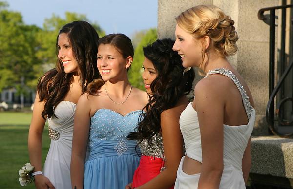 Salem High School prom goers from left, Brandi Lavoie, Kaira Colman, Dasha Corpuz, and Alysaa Copelas, pose for photos at Salem Common on Friday evening. David Le/Staff Photo