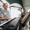Retired Beverly Music Teacher Ray Novack, left, plays with his band, the Ray Novack Jazz Trio, at the North Shore Concours d'Elegance at Misselwood on the campus of Endicott College on Sunday afternoon. David Le/Staff Photo