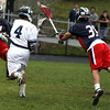 Danvers: Despite Lincoln-Sudbury's Senior goalie, Greg Majno's efforts, St. John's Prep Senior attackman, Garrett Campbell scores in the Eagles' Division 1 Semi-Final win Saturday afternoon in Danvers. Photo by David Le/Salem News