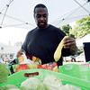 Alex Perez, of Beverly, picks out some summer squash at Beverly Boostraps Mobile Market on Tuesday afternoon. David Le/Staff Photo