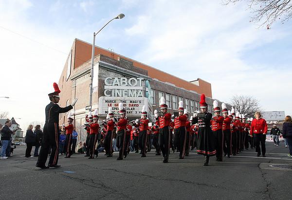 The Salem High School marches past the Cabot St. Cinema on Sunday afternoon. David Le/Salem News