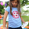 Olivia Andrianopoulos, 6, from Ann Arbor, MI, makes a piece of artwork at the Salem Jazz and Soul Festival on Saturday morning. David Le/Staff Photo
