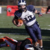 Swampscott quarterback Mike Walsh gets tripped up by Beverly's (33) during the first half of play. David Le/Salem News