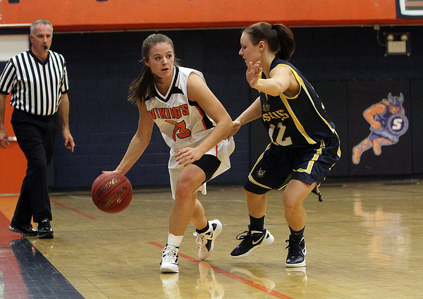 Salem State guard Bridget Dullea (23) left, shields USM defender Kimberly Rivet (12) right, and looks for a teammate. David Le/Salem News