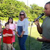 The Rice family from left, Alyssa, 13, Ryan, 8, Katelyn, 10, and Amy, listen as Chris Collinsworth, from NECN Sports, talks about playing baseball with fallen Peabody firefighter Jim Rice back during the 1985 season. David Le/Staff Photo