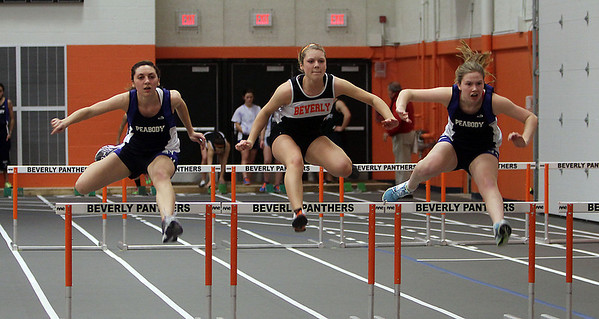 Peabody's Sarah Athas, left, Beverly's Taylor Kunselman, and Peabody's Rachel Barrett compete in the 50 meter high hurdles on Thursday afternoon. David Le/Salem News