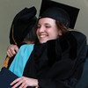 Endicott College senior Bailey Marquis, right, hugs Vice President of the Undergraduate College, Laura Rossi-Le, after receiving her diploma during Commencement on Saturday morning. David Le/Staff Photo