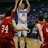 Danvers junior Nick Bates (15) hits a jump shot in front of three Saugus defenders during the D3 North Final at the Tsongas Center in Lowell on Saturday afternoon. David Le/Staff Photo