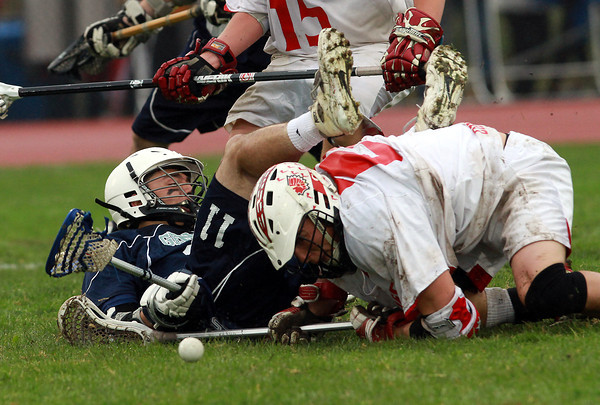 Hamilton-Wenham's Ben Koz (11) left, gets upended by Masco's Tim Towler during a scrum for a loose ball on Tuesday afternoon. David Le/Staff Photo
