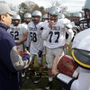 Hamilton-Wenham head coach Andrew Morency talks with his offense on Sunday morning. David Le/Salem News