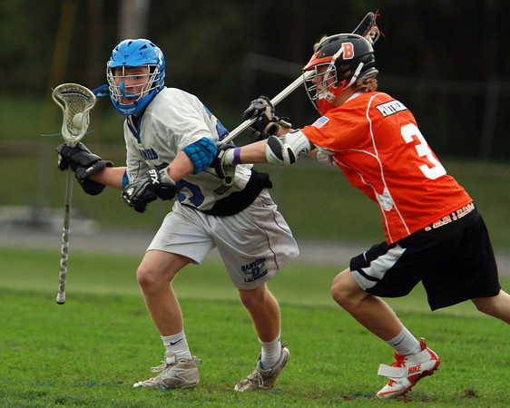Danvers attacker Jay Calcagno, left, tries to get past Beverly defender Ty Martz, right, during the second quarter of play on Thursday evening. David Le/Staff Photo
