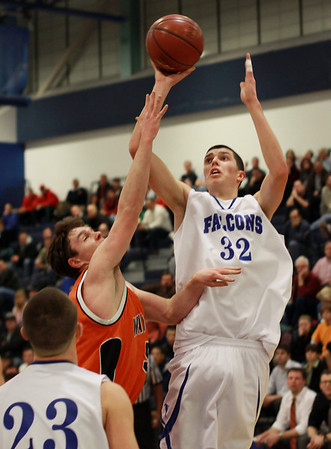Danvers senior George Merry (32) rises up over a Wayland defender to hit a shot. David Le/Staff Photo