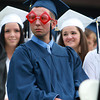 Peabody High School graduate Mike Gould sports colorful graduation glasses on Friday, David Le/Staff Photo