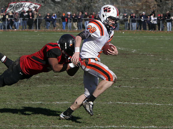 Beverly running back Kenny Pierce (28) right, drags a Salem defender as he tries to get in the endzone. David Le/Salem News