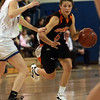 Ipswich freshman point guard Masey Zegarowski (5), right, drives past a Bedford defender. David Le/Staff Photo