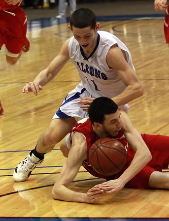 Danvers junior captain Eric Martin (11) left, dives for a loose ball and lands on Saugus center Selim Omerovic, right, during the D3 North Final at the Tsongas Center on Saturday. David Le/Staff Photo