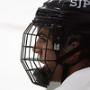 St. John's Prep senior captain Sam Kurker watches the action on ice as he takes a breather on the bench. David Le/Staff Photo