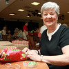 Janet Channell wraps a present for Operation Troop Support at Brooksby Village on Saturday morning. David Le/Staff Photo
