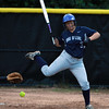 Swampscott batter Bridget Genoversa-Wong tries to leap out of the way of an inside pitch. David Le/Staff Photo