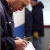 St. John's Prep assistant coach _____________ jots down some last minute notes before gametime. David Le/Staff Photo