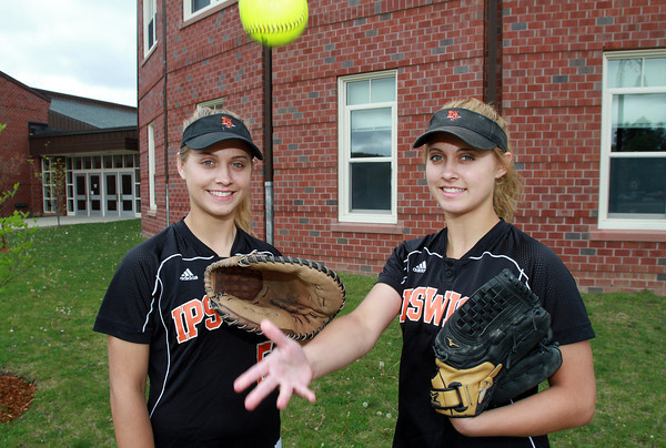 Ipswich High School senior captains and identical twins Rachel, left, and Katie Glaubitz, are battery mates for the Tigers. Katie pitches, while Rachel plays catcher and centerfield. David Le/Staff Photo