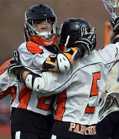 Beverly players celebrate a goal by Dom Abate (5) right against Malden Catholic on Saturday afternoon. David Le/Staff Photo