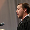 Salem State University Graduate student Cole Lundquist, sings the National Anthem at the start of the Commencement ceremony on Thursday afternoon. David Le/Staff Photo