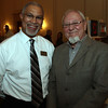 Thomas MacDonald, left, Director of Sales for the Hawthorne Hotel, and Henry Zbyszynski, local photographer and member of the Salem Arts Association, at the 2nd annual exhibit for artists and authors. David Le/Staff Photo