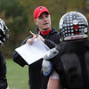 Marblehead High School football coach Jim Rudloff talks with some of his players during practice on Thursday as they gear up for their game on Friday. David Le/Salem News