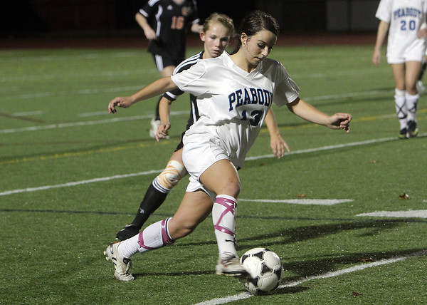 Peabody High School junior striker Victoria Digiacomo (13) carries the ball against Oliver Ames on Tuesday. Digiacomo knocked home the winning goal in overtime to propel Peabody to a 2-1 win. David Le/Salem News