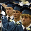 North Shore Tech graduate Max Brown listens to a speech given by Senator Bruce Tarr during North Shore Tech's Graduation Ceremonies on Friday evening. David Le/Staff Photo