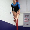 Danvers gymnast Jackie Veatch flips off the vault on Friday night. David Le/Salem News