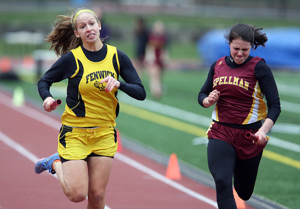 Bishop Fenwick junior Becky Mercuro, left, and Spellman senior Alex Panotano sprint towards a photo finish in the 4x100 meter relay on Thursday afternoon. David Le/Staff Photo