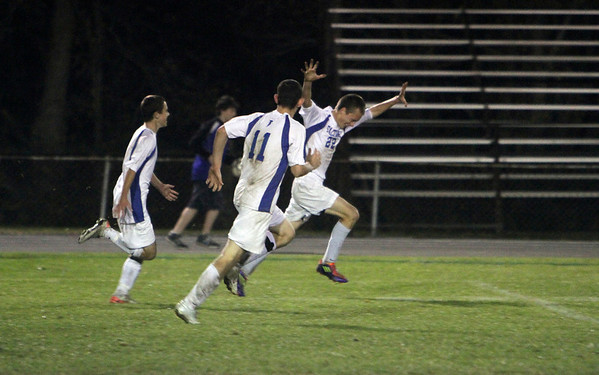 Danvers High School senior Jon Wright (22) right, runs with his arms outstretched after he buried a goal in the final minute of play against Pentucket on Wednesday night to propel the Falcons' to a 2-1 vicotry. David Le/Salem News