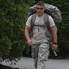 Marblehead: Jamie Wade, 20, of Marblehead, an infantryman with the National Guard, 1st Battalion 181 Infantry, hikes around the streets of Marblehead Neck with a full pack as part of a conditioning excersize on Wednesday afternoon. Photo by David Le/Salem News