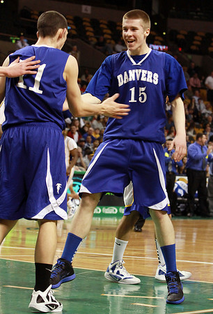 Danvers junior Nick Bates (15) right, congratulates junior Eric Martin (11) left, after he converted a layup and got fouled in the process against Wareham on Monday afternoon. David Le/Staff Photo