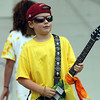 "Finn Moran, 9, plays guitar along to the tune of ""Here Comes the Sun"" by the Beatles during the Annual Beverly Homecoming Lip Synching Competition on Tuesday. David Le/Staff Photo"