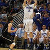 Danvers junior Nick Bates (15) rises up and hits a jump shot against St. Joseph's on Saturday during the D3 State Championship at the DCU Center in Worcester. David Le/Staff Photo