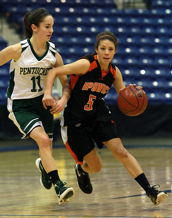 Ipswich freshman point guard Masey Zegarowski (5), right, drives past Pentucket's Alex Moore (11) during the first half of play. The Tigers fell to the Sachems in the Girls D3 North FInal at the Tsongas Center in Lowell on Saturday morning. David Le/Staff Photo