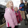 Sisters Shannon, 5, and Courtney Hitscherich, 3, of Marblehead, watch as Charlie Fogarty, a balloon-man from Gloucester makes them Christmas themed hats on Sunday afternoon. David Le/Salem News