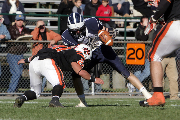 Swampscott High School's Aidan Lang (6) manages to hold onto the ball despite a big hit from Beverly's Nick Theriault on Saturday afternoon. David Le/Salem News