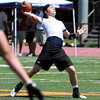 St. John's Prep quarterback Jack Sharrio drops bak to pass during a 7 on 7 Tournament at Bishop Fenwick High School on Saturday. David Le/Staff Photo