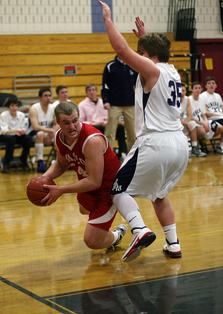 Masco's Kurt Hunziker (14) looks to pass around Hamilton-Wenham's Shane Jenkins (35) as he falls to the floor. David Le/Salem News